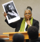 Sharon McGriff-Payne Holds Picture of Delilah Beasley